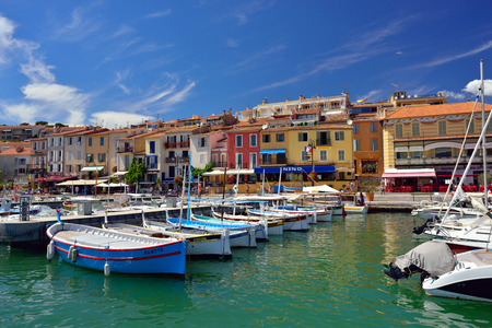 cote d'azur: CASSIS, FRANCE - JUL R 14, 2014: A picturesque tourist port in the south of France called Cassis. Cassis is a famous port where tourists charter boats to view the calanques. Editorial