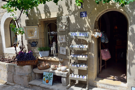 LES BAUX, FRANCE - JUL 9, 2014:Souvenir shop in village of  les Baux. Les Baux is now given over entirely to the tourist trade, relying on a reputation as one of the most picturesque villages in France
