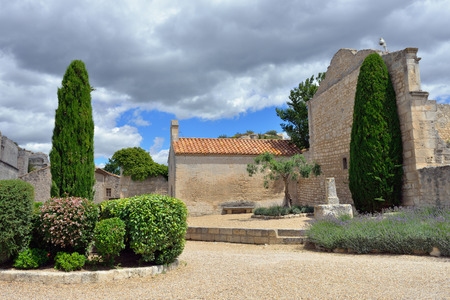 relying: Courtyard of the castle les Baux. Les Baux is now given over entirely to the tourist trade, relying on a reputation as one of the most picturesque villages in France