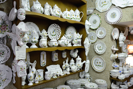incomparable: MOUSTIERS SAINTE-MARIE, FRANCE - JUL 18, 2014: Atelier Mufraggi ceramics shop. Moustiers Sainte-Marie is known all over the world for its ceramics with incomparable refinement and decors. Editorial