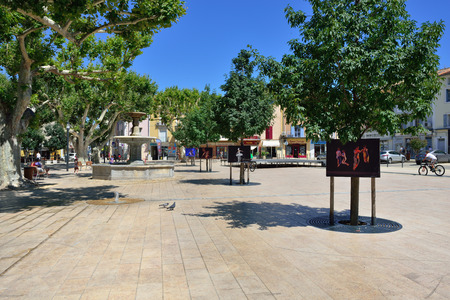 cited: PROVENCE, FRANCE - JULY 15, 2014: Central square of beautiful medieval village of Vaison la Romaine. The area was inhabited in the Bronze Age. Editorial