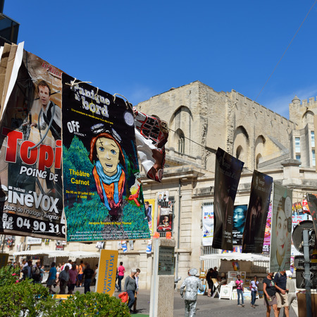 AVIGNON, FRANCE - JULY 12, 2014: Posters on the wall during annual Avignon Theater Festival, which in 2014 was attended around 500 theater companies in Avignon, France on July.
