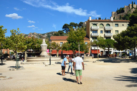 CASSIS, FRANCE - 14 JUL, 2014: Petanque players in central square of Cassis, French Riviera. Most popular game for local people in all season Editorial