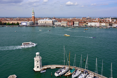 above 21: VENICE, ITALY - SEPT 21, 2014: View from above on San Marco square in Venice.Tourists from all the world enjoy the historical city of Venezia in Italy, famous UNESCO World Heritage Site