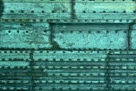 Background of copper coated with a green patina photo