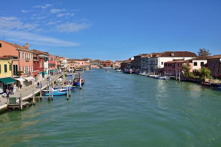 murano: MURANO - SEP 22, 2014: Water canal at Murano island, Venice. Landmark of Veneto region, Italy