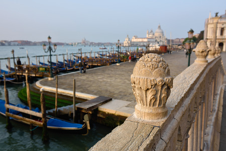 saint mark square: View on San Marco square and venetian lagoon from bridge of Sighs at sunrise. Venice, Italy. Small depth of field Stock Photo