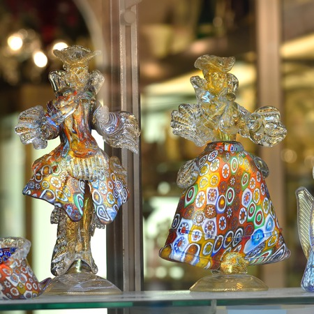 crystalline gold: MURANO, ITALY - SEP 25, 2014: Glass figurines from murano glasses displayed in a shop window. Today, Murano is home to a vast number of factories  making all manner of glass objects