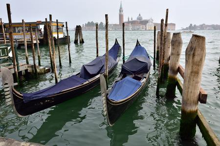 saint mark square: Gondola moored by Saint Mark square with San Giorgio di Maggiore church in the background, Venice, Italy, Europe