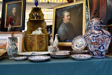 VENICE, ITALY - SEP 21, 2014: Old glassware, china, tableware, silver, arts, etc for sale at Venice Campo San Maurizio flea market. This flea market serves the professional antique dealers.