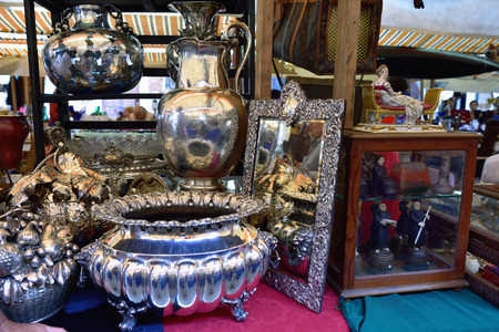 VENICE, ITALY - SEP 21, 2014: Old glassware, silver, arts, etc for sale at Venice Campo San Maurizio flea market. This flea market serves the professional antique dealers.