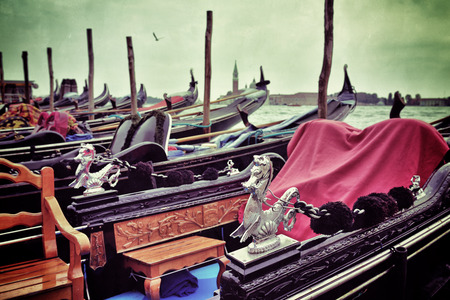 saint mark square: Gondola moored by Saint Mark square with San Giorgio di Maggiore church in the background at sunrise - Venice, Italy, Europe. Filtered image. Vintage effect applied
