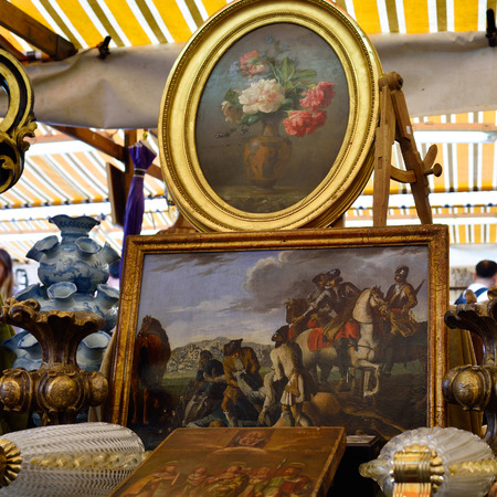 VENICE, ITALY - SEP 21, 2014: Vintage objects, arts, etc for sale at Venice Campo San Maurizio flea market. This flea market serves the professional antique dealers. Editorial