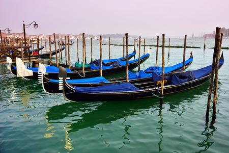 saint mark square: Gondola moored by Saint Mark square in Venice at sunrise, Italy, Europe. Stock Photo