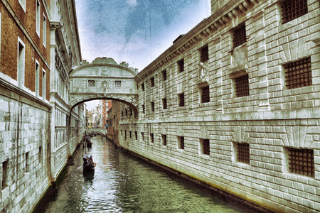 saint mark's square: View on canal and  Doges Palace from bridge of sighs in Venice at sunrise. Palazzo Ducale at Saint Marks Square in Venice, Italy. Filtered image Editorial