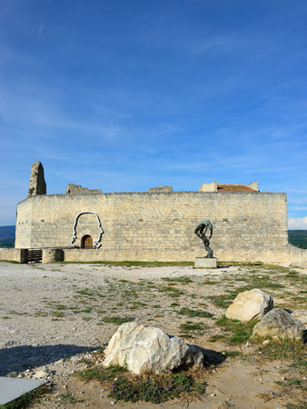 LACOSTE, FRANCE - JUL 11, 2014: Square and  Statue of Marquis de Sade in front ruins of his castle  The terms sadist and sadism are derived from Marquis de Sade Editorial