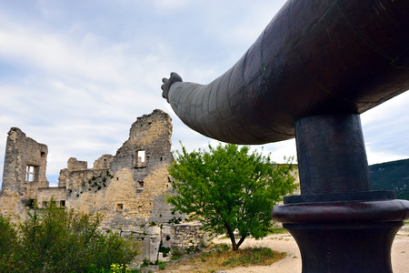 the luberon: LACOSTE, FRANCE - JUL 07, 2014: Iron hand points on  ruins of the castle Marquis de Sade in Lacoste, France. Lacoste is located in the heart of the Luberon Regional Nature Park