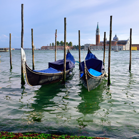 saint mark square: Gondolas moored by Saint Mark square with San Giorgio di Maggiore church in the background at sunset - Venice, Italy, Europe