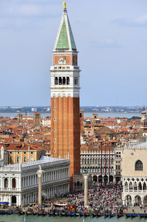 VENICE, ITALY - SEPT 21, 2014: View from above on San Marco square in Venice.Tourists from all the world enjoy the historical city of Venezia in Italy, famous UNESCO World Heritage Site