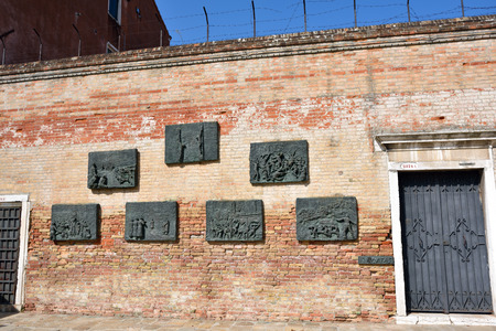 deported: VENICE, ITALY - SEPT 22, 2014: The bas-relief panels in the Campo Di Ghetto Nuova square commemorating Venetian Jews who were deported by the Nazis Editorial