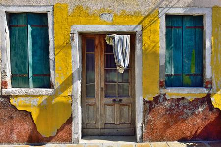 Burano island, Venice. Facade of the old house. Colorful houses island and landmark of Veneto region, Italy