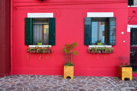 Burano island, Venice. Decorated facade of the house. Colorful houses island and landmark of Veneto region, Italy