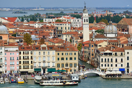 above 21: VENICE, ITALY - SEPT 21, 2014: View from above on Venice.Tourists from all the world enjoy the historical city of Venezia in Italy, famous UNESCO World Heritage Site