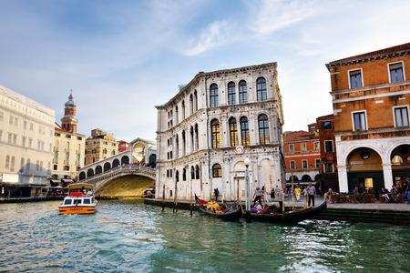 rialto bridge: VENICE,ITALY-SEPT 24, 2014: Grand Canal an the Rialto Bridge  (Ponte Di Rialto) with tourists in Venice at sunset. This bridge is the oldest bridge accross the Grand Canal in Venice. Editorial