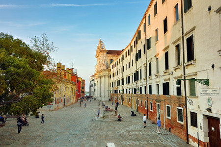 sestiere: VENICE, ITALY - SEP 23, 2014: View on square Campo dei Gesuiti at sunset and the church of Santa Maria Assunta, known as I Gesuiti. It is located in the sestiere of Cannaregio, not far from the Fondamenta Nuove