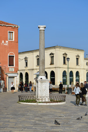 owes: MURANO, ITALY - SEP 26, 2014: Colonna romana. Owes its fame to the scientist Galileo Galilei, who used it as a reference point to present. You could see through his new invention, the telescope from the Campanile di San Marco