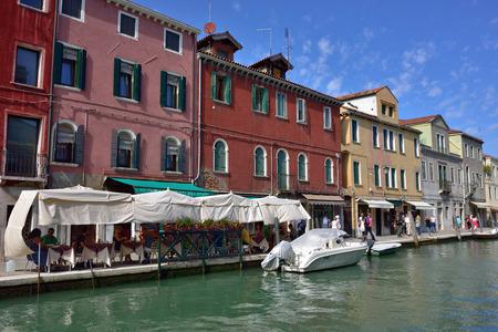 Murano: MURANO - SEP 22, 2014: Tourists from all the World are walking along water canal famous Murano island, Venice. Landmark of Veneto region, Italy Editorial