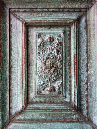 copper coated: Background of ancient copper bas-relief coated with a green patina Stock Photo