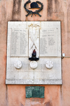 regiment: BURANO - SEP 26, 2014: View of Memorial in central square at Burano island in Venice, Italy. Memorial was built to those who died in the Great War and WWII