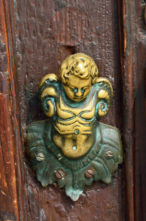 Angel, Ancient door knob from Venice, Italy photo