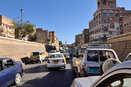 trafic: SANAA, YEMEN - MARCH 6, 2010: Trafic at central street in old city of Sanaa. Inhabited for more than 2.500 years at an altitude of 2.200 m, the Old City of Sanaa is a UNESCO World Heritage City