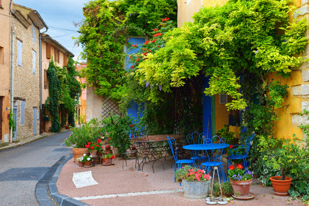 Beautiful street in Villes-sur-Auzon at evening time, Provence, France.