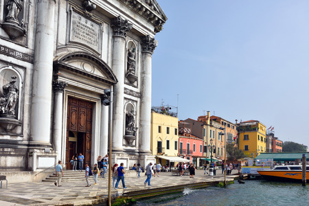 temperance: VENICE, ITALY - SEPT 21, 2014: Church Chiesa dei Gesuati and venetian seafront shown at morning. Tourists from all the world enjoy the historical city of Venezia in Italy, famous UNESCO World Heritage Site