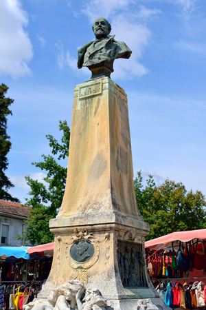 felix: A statue of Alphonse Benoit by Felix Charpentier sculptor in village of  l Editorial