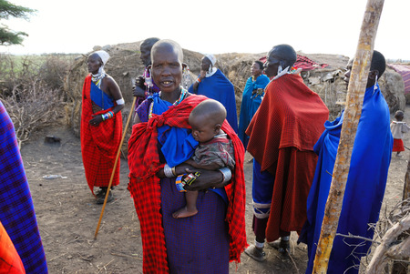 dirty clothes: NGORONGORO CONSERVATION AREA, TANZANIA - JAN 24, 2008: Unidentified tanzanian people from Masai tribe dressed with simple and dirty clothes shown in a village near Ngorongoro crater, one of the famous national reserve parks in Tanzania