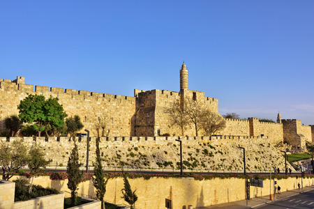 crusade: The walls of the eternal Jerusalem at sunset. Warm evening light illuminates the ancient walls and Tower of David