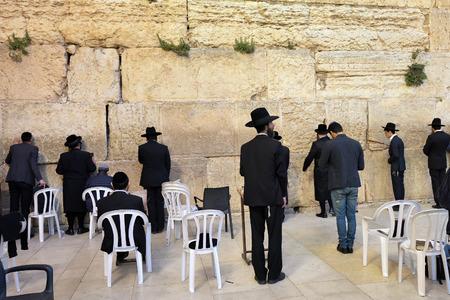 wailing: JERUSALEM, ISRAEL - MARCH 29, 2015 : Jewish worshipers pray at Wailing Wall in Jerusalem after sunset, Israel