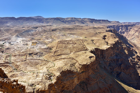 siege: The dramatic archaeological site of Masada. View from fortress at the roman military camp F, built the Legio X Fretensis during the siege operation in 72 C.E.