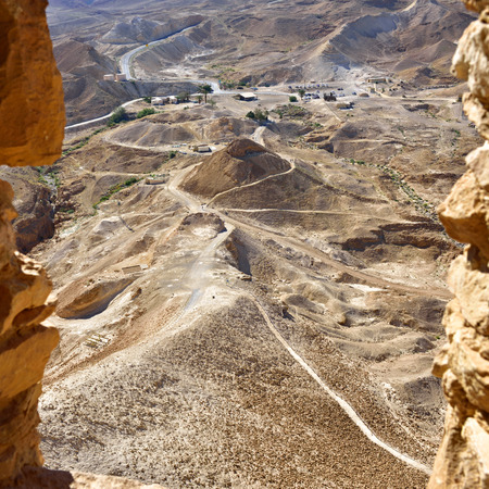 israel war: View on siege embankment against the western face of the zealot fortress Masada built Legio X Fretensis during First Jewish-Roman War in 72 CE. Israel