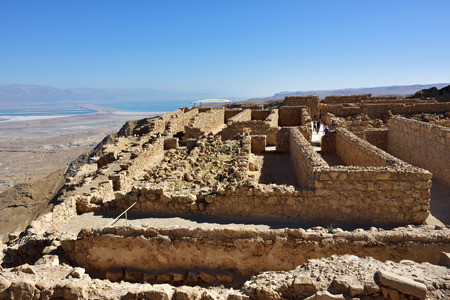 dead sea: View on the ruins of the zealot fortress Masada, the Dead sea on background. Judean desert, Israel Stock Photo