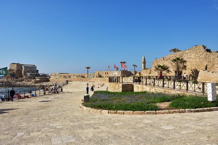caesarea: CAESAREA ISRAEL APR June 2015: Caesarea Maritima National Park Ancient Roman city shown at sunset time. Very popular place for resting between local people and tourists