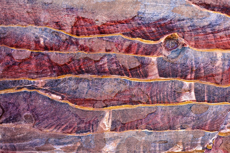 Abstract colorful patterns in sandstone cliff of world wonder Petra Jordan