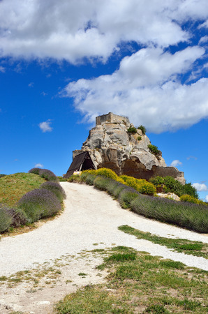 relying: The castle of les Baux. Les Baux is now given over entirely to the tourist trade, relying on a reputation as one of the most picturesque villages in France