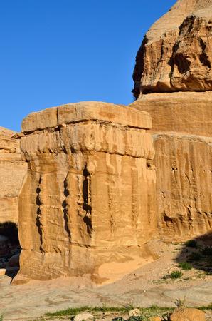 Djinn blocks cubeshaped monuments in Petra at sunset light Jordan
