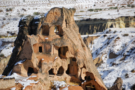 dwelling: Lone rock with dwelling cave standing in Cappadocia Turkey Stock Photo