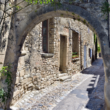 romaine: France Provence. Typical narrow street with stone arch in medieval village Vaison la Romaine Stock Photo